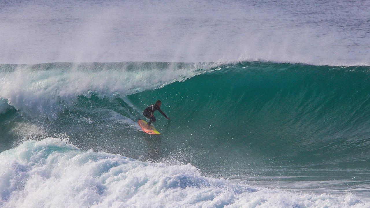 Alex Unwin surfing waves in winter