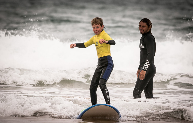 kid learns to surf with fun